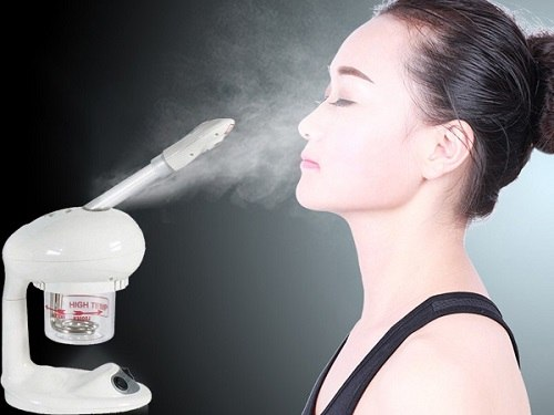 Woman steaming face with Silver Fox Portable Mini Facial Steamer